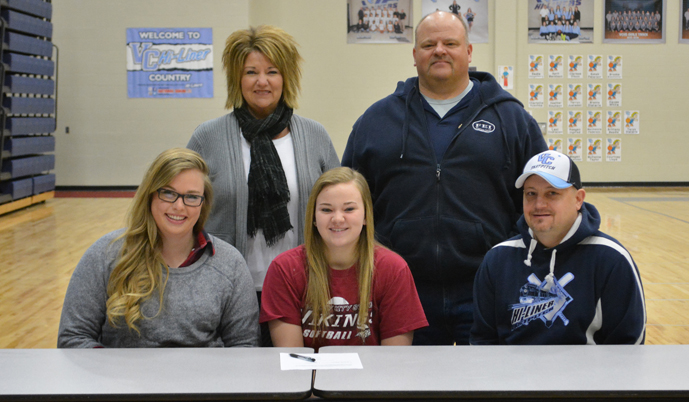Valley City High School's Brooke Breckheimer signs her letter of intent with her parents (back) and VCHS coaches.