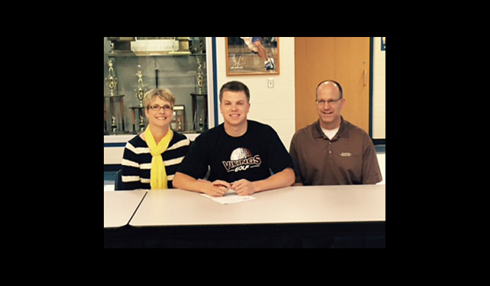 Jared Lentz signs his letter of intent Wednesday with parents Mike and Kathy Lentz.