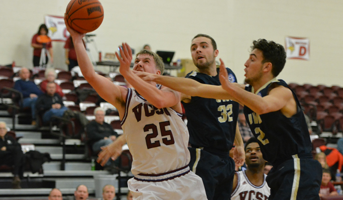 Briton Bussman battles through the defense for a basket Friday night against Johnson & Wales.