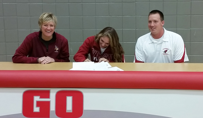 Courtney Magnuson signs her letter of intent Thursday, flanked by VCSU coach Jill DeVries and Willmar coach Dustin Carlson.