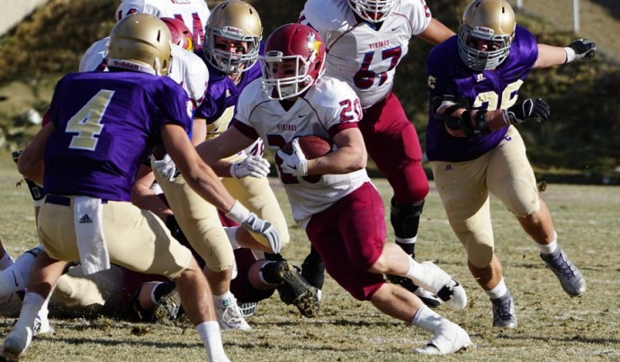 VCSU running back Ian Keller carries the ball Saturday at Carroll. (Steve Collins/VCSU)
