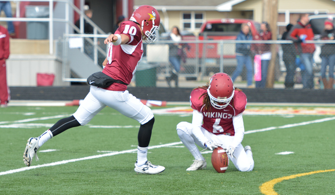 VCSU senior Thomas Cortes kicks an extra point Saturday as Antoine Griffin holds. (Mark Potts/VCSU)
