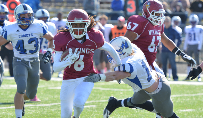 Viking receiver Antoine Griffin breaks a tackle Saturday against Mayville State.