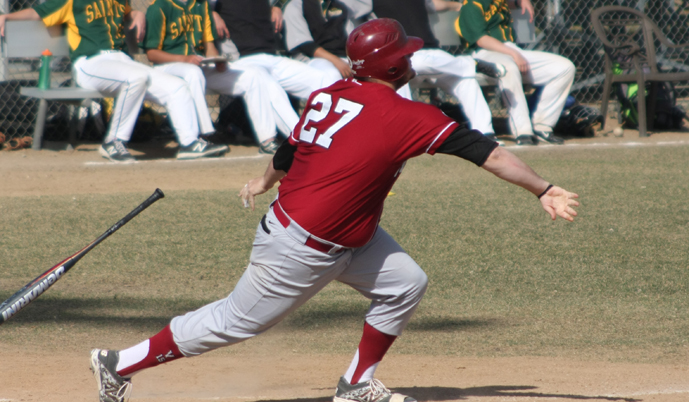 Tom Houdek follows through on a hit Saturday against Presentation College (Photo Credit: Alan Hirsch)