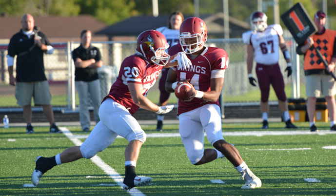VCSU runningback Ian Keller takes a handoff from Kurtis Walls on Saturday night. (Mark Potts/VCSU)