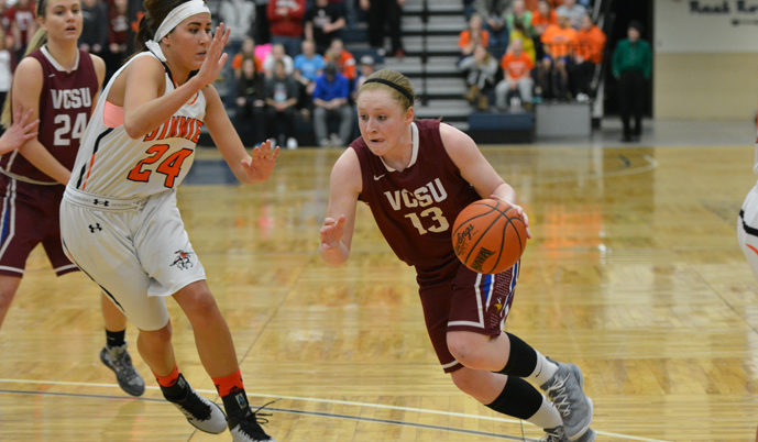 VCSU's Lexi Lennon drives to the hoop against Jamestown's Jessica Buck on Tuesday.