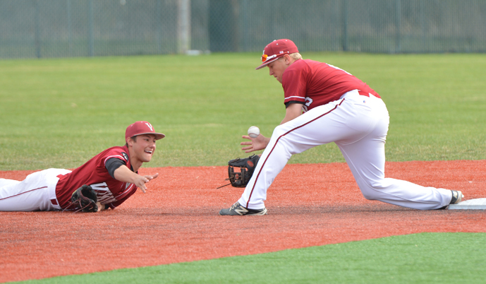 Viking shortstop Jared Meiklejohn flips the ball to Jake Rambow for an out at second base. (Mark Potts)