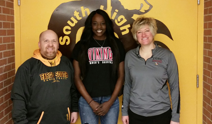 Nya Chakin with Fargo South head coach Jason Smedshammer, left, and VCSU head coach Jill DeVries.