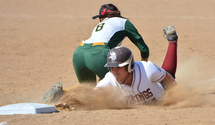 VCSU's Taylor Schroeder dives back to first base safely Saturday against Presentation College.