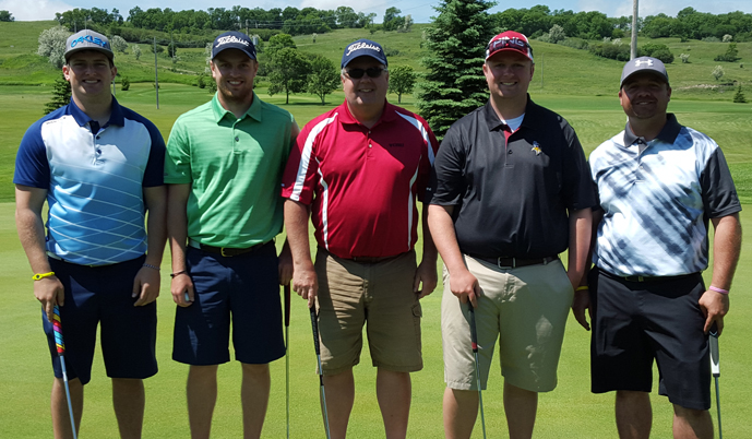 The Viking Scramble champions, from left: Shane Ost �15, Ben Sorenson, Tim Sorenson �83, Matt Sorenson �13, and TJ Hansen �04
