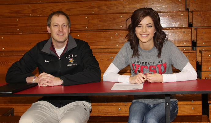 Emily Weatherstone signs her letter of intent with VCSU volleyball coach Adam Longmore. (Photo credit: Sisseton Courier)