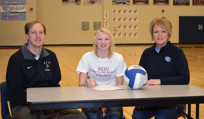 VCHS senior Clarissa Olson signs her Letter of Intent Friday with VCSU head coach Adam Longmore and VCHS coach Jill Taylor.