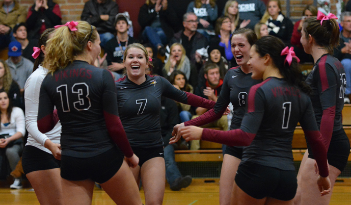 VCSU celebrates a point Friday night against Presentation College. (Mark Potts/VCSU)