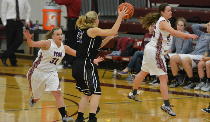 VCSU's Tracie Boehmlehner, left, and Megan Trautman apply pressure defense Monday. The Vikings forced 46 turnovers.
