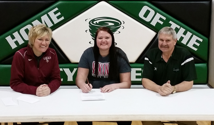 Mackenzie Huber signs her letter of intent Tuesday with VCSU coach Jill DeVries and Clark High School coach Mark Prouty.