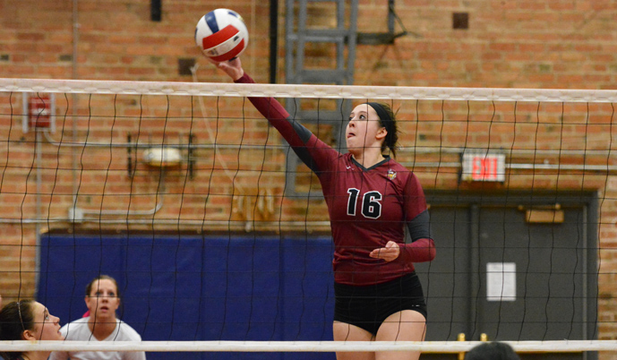 VCSU's Kaitlyn Heuring hits a ball Wednesday as Megan Good, left, and Jen Wettstein cover.