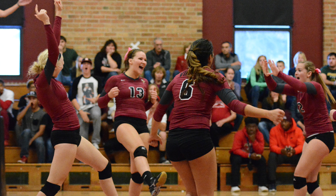 VCSU's volleyball team celebrates a point Saturday against Dickinson. (Mark Potts/VCSU)
