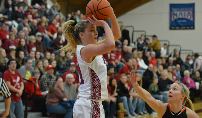 VCSU's Georgia Williams shoots over Jamestown's Kyra Dewald during last season's game in Valley City.