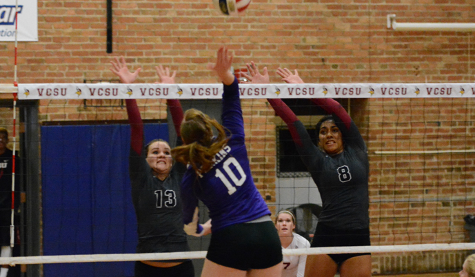 Barb Ector (13) and Chelzie-Kristina Ulu (8) go up for a block Saturday against Waldorf. (Mark Potts/VCSU)