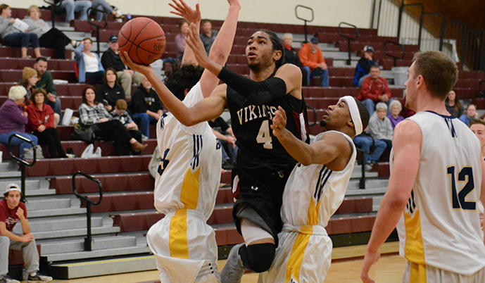 Rashad Satahoo slips through the defense for a shot Sunday in Valley City.