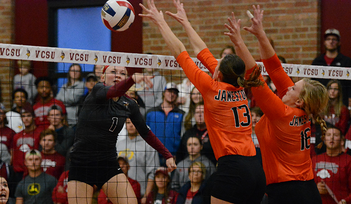 Clarissa Olson scores a kill past the block of Jamestown's Haley Glasoe (13) and Heather Bachman (16).
