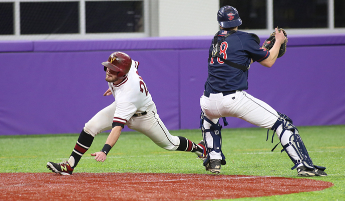 VCSU's Brady Anderson avoids a tag to score a run Wednesday. (Credit: d3photography.com)