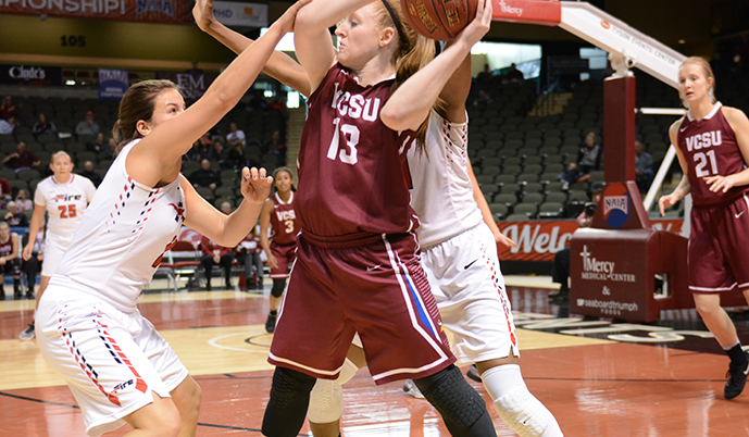 VCSU's Lexi Lennon trys to pass out of a double-team Thursday at the NAIA National Tournament.