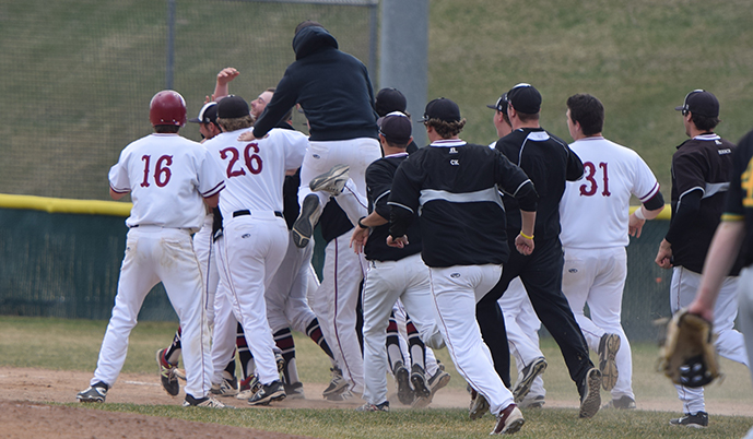 Members of the VCSU baseball team mob teammate Brady Anderson after his walk-off hit Friday. (Jake Pommerer/VCSU)