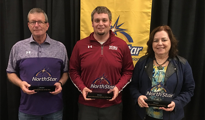 VCSU's Mark Potts, center, was named the NSAA SID of the Year on Wednesday.