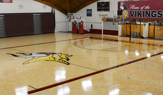 The basketball floor at the W.E. Osmon Fieldhouse received a new look this summer.