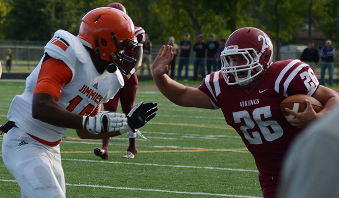 VCSU's Jacob Duilio stiff arms a Jamestown defender Thursday night. (Morgan Nalley/VCSU)