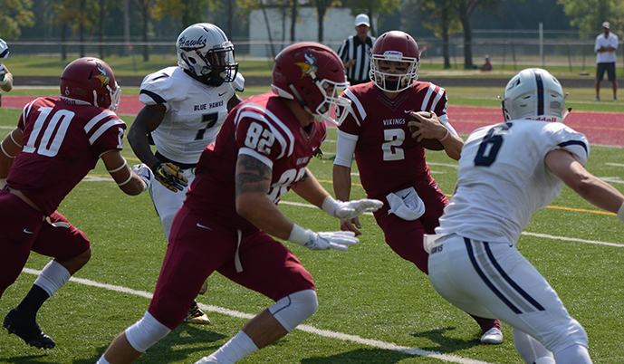 VCSU quarterback Jalen Pfeifer (2) scrambles as Tayler Lentz (82) and Louis Quinones (10) block. (Spencer Aune/VCSU)