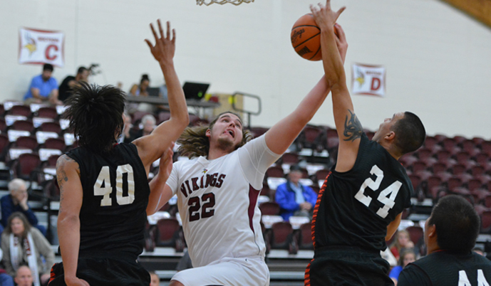 VCSU's Quin Peterson battles for a rebound Saturday.